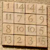 A photograph of Josep Subirachs magic square on the Sagrada Familia cathedral, Barcelona